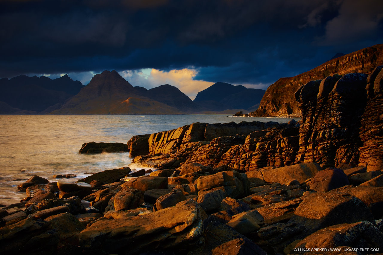 Clouds hang over the Cuillin mountains when the sun sets in Elgol in the Isle of Skye, Scotland.
