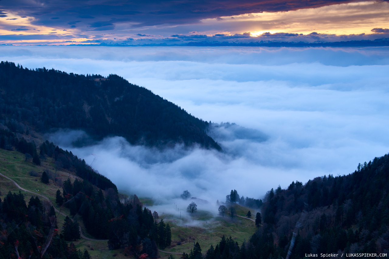 The sun rises above the fog-covered Swiss lowland.
