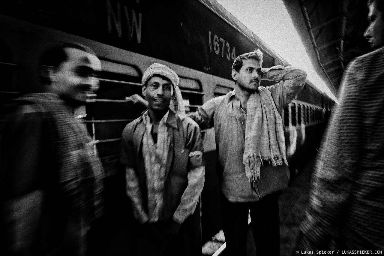 Porters relax after another train has arrived. India has one of the largest railway networks of the world. Introduced under British rule almost 160 years ago, the railway nowadays is infamous for overcrowded and delayed trains.