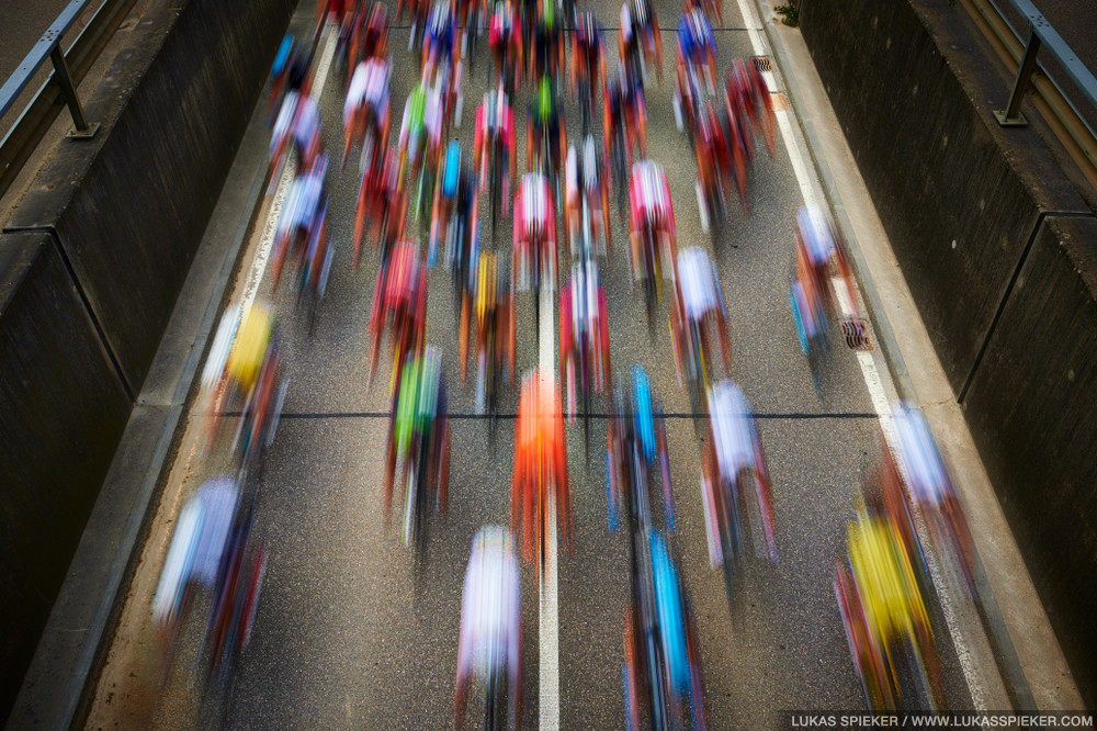 Riders race through Arch during the Tour de Suisse, Switzerland June 18, 2014.
