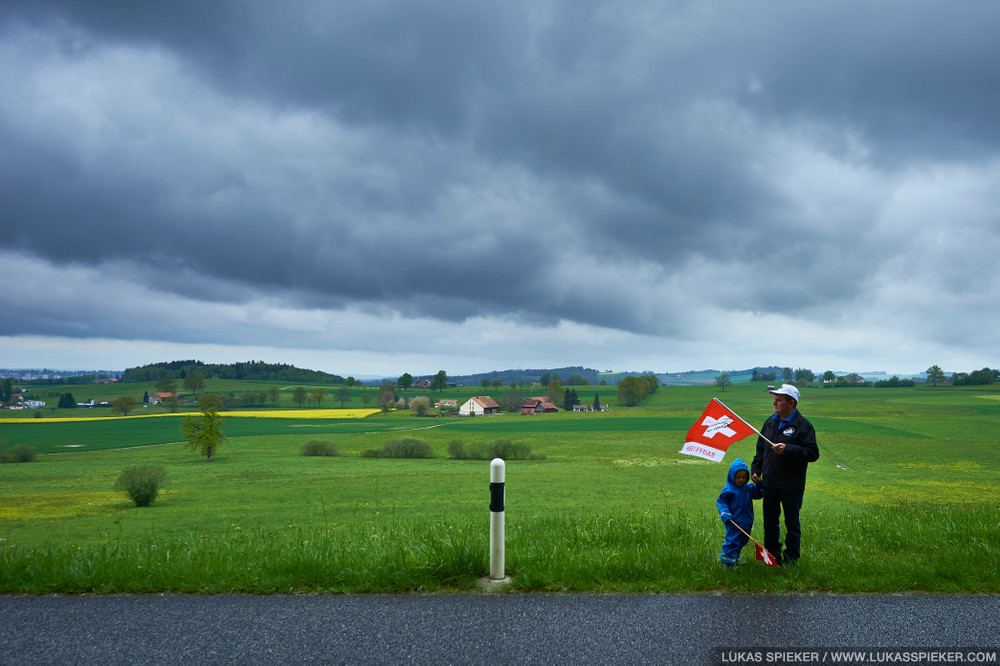 Spectators near Fribourg wait for the racers in stage 4 of the Tour de Romandie in Switzerland May 3, 2014.